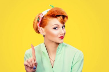 woman gesturing a no sign. serious pinup retro style girl raising finger up saying oh no
