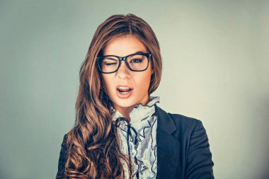 Successful business woman with glasses winking