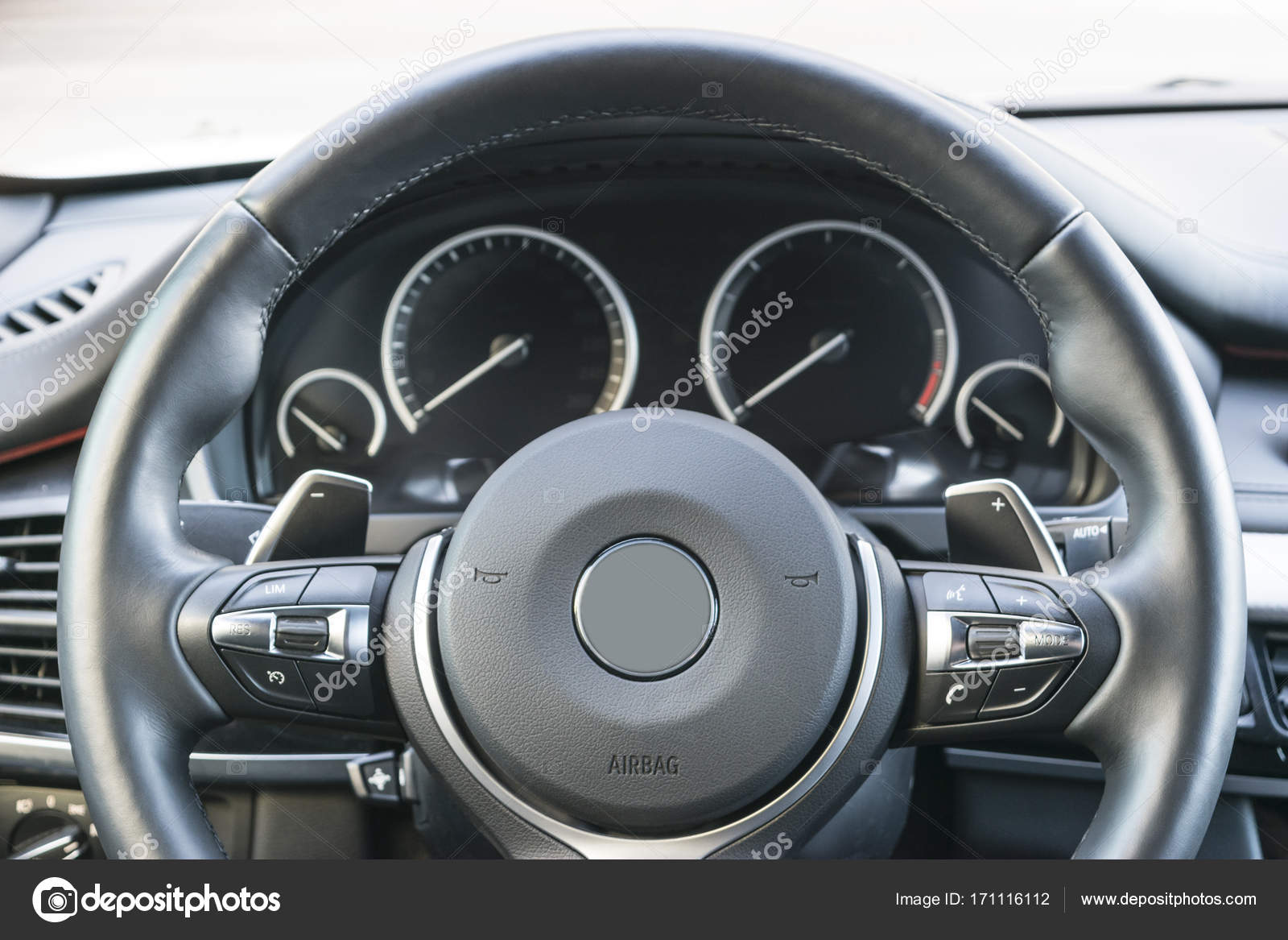 Close Up Of Steering Wheel Car Dashboard Navigation Screen Modern