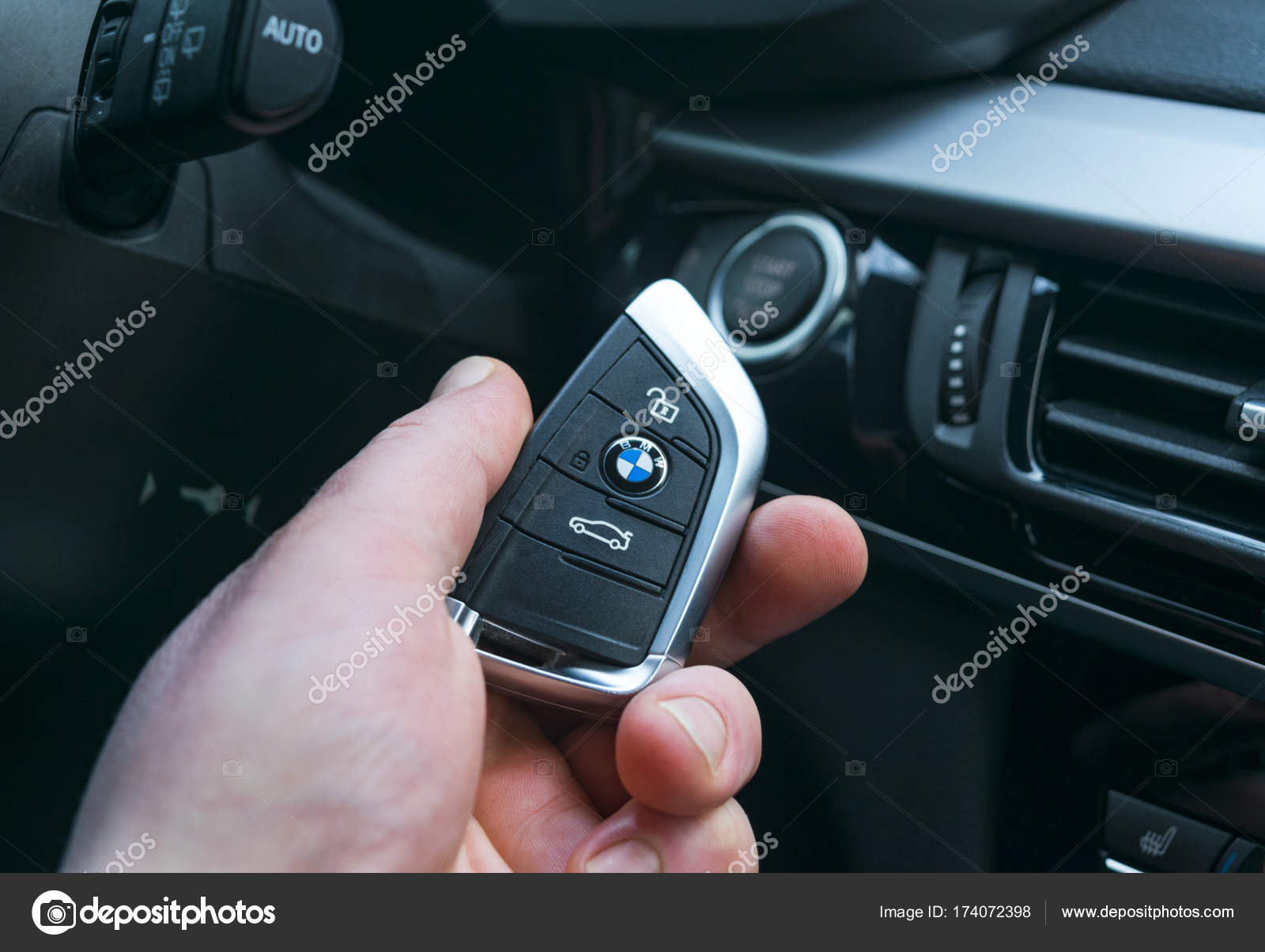 Man S Hand Holding A Wireless Bmw X5 F15 Car Key In Black Leather