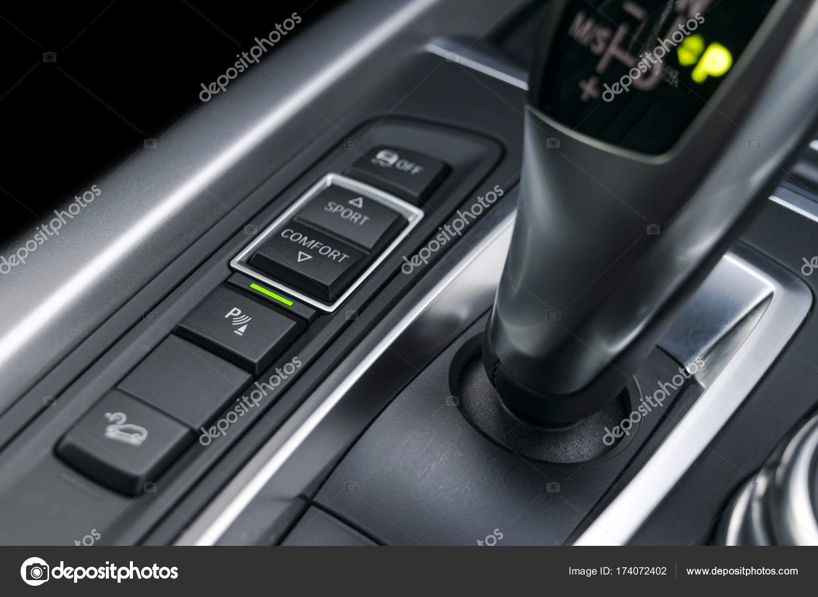 Track and parking sensor control buttons near automatic gear stick