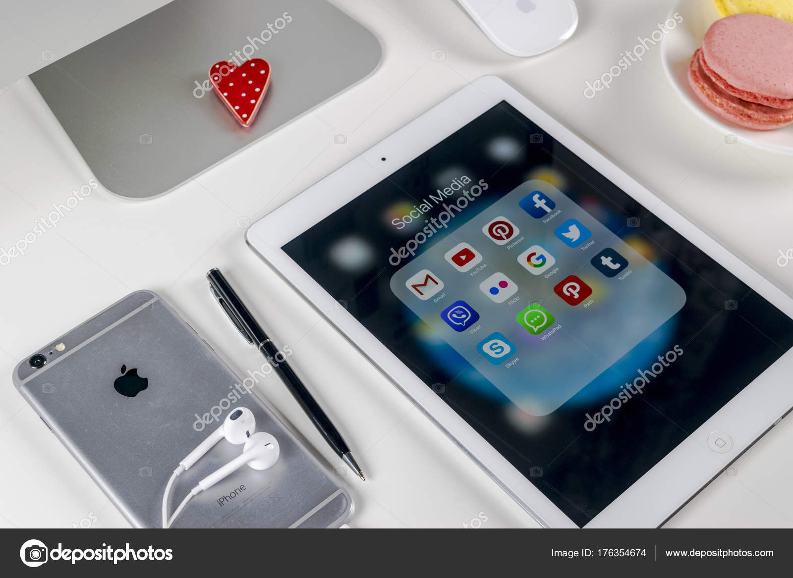 Apple iPad Pro on office table with icons of social media facebook