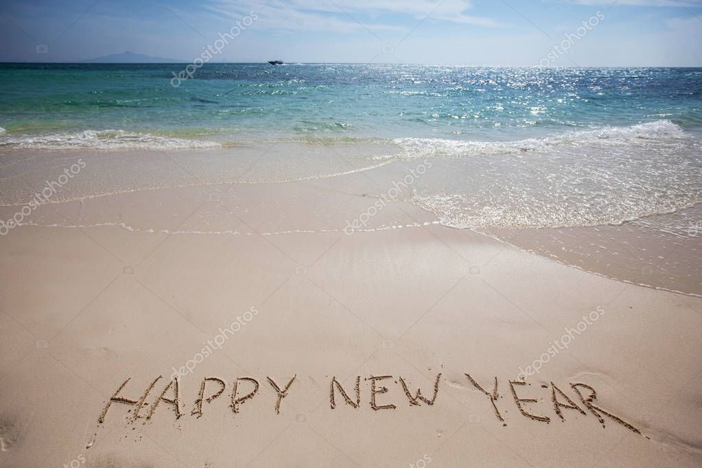 happy new year on beach stock photo
