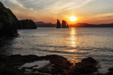 Beautiful seascape: view of rocks in sea at sunset