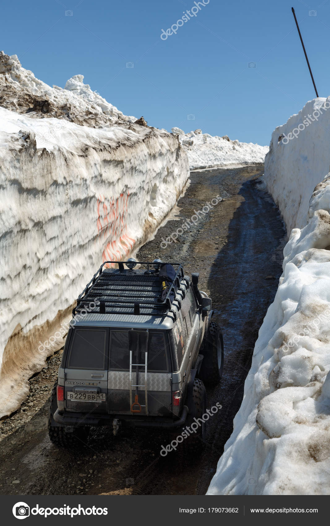 Off Road Cars Toyota Land Cruiser Prado Driving On Mountain In Snow Tunnel Surrounded