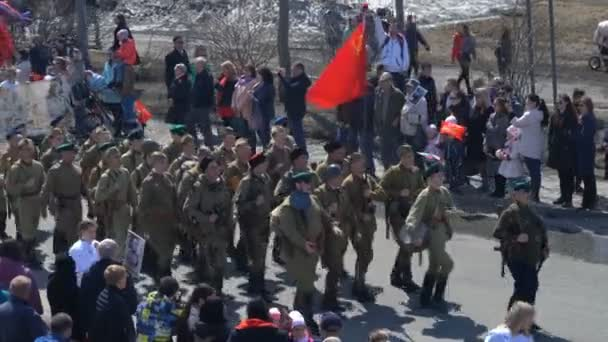 PETROPAVLOVSK KAMCHATSKY CITY, KAMCHATKA PENINSULA, RUSSIAN FAR EAST - MAY 9, 2018: Russian Action Immortal Regiment event participants in military uniform of Great Patriotic War marching along city street.