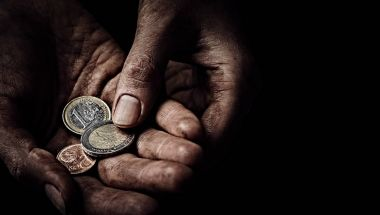 Beggar hands with few coins