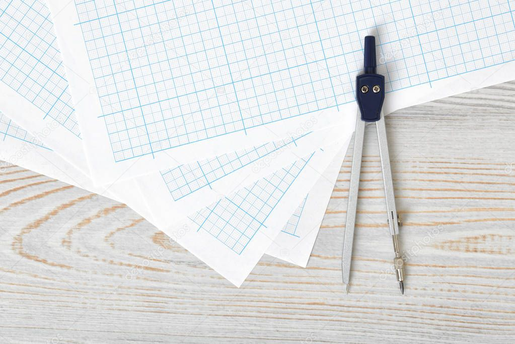 compass on graph paper in top view with copy space stock photo
