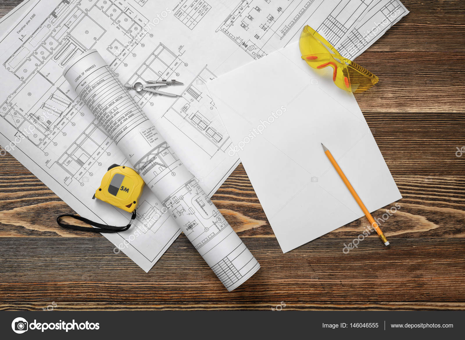 Blueprints pencil protective glasses steel tape pencil and white blueprints pencil protective glasses steel tape pencil and white paper lying on wooden table background construction and renovation malvernweather Gallery