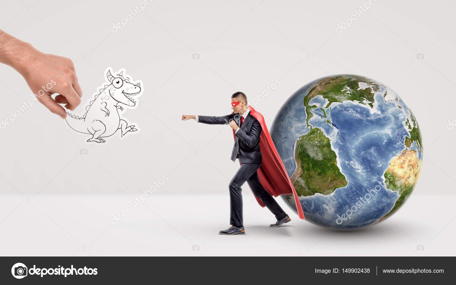 A small businessman in superhero cape beside a globe ready
