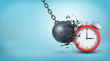 3d rendering of a big black iron wrecking ball breaks itself when hitting a large red alarm clock.