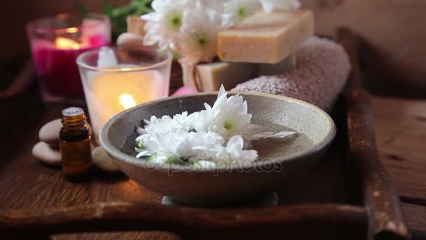Spa setting.Adding olive oil in floral water for skin treatments