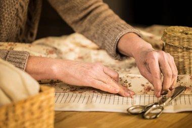 Woman sewing cloth