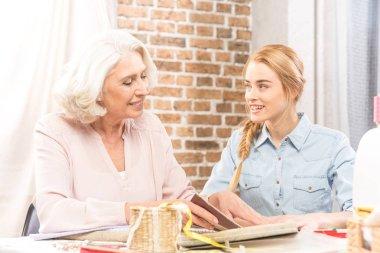 Senior woman and girl chatting
