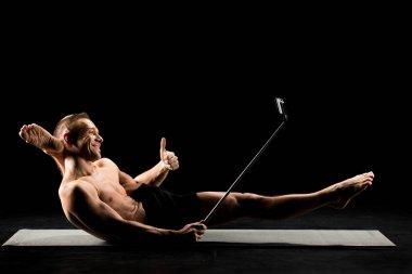Yoga man taking selfie