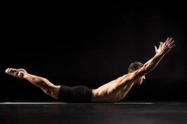 Man lying in yoga position