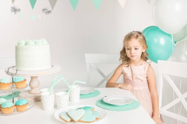 Adorable girl at birthday table
