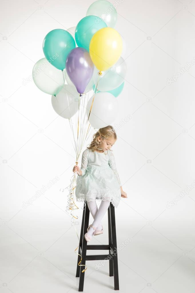 Girl with air balloons