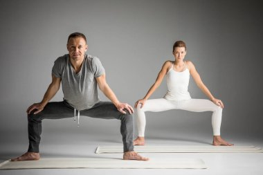 Couple practicing yoga