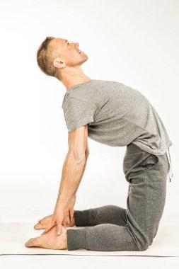 Man standing in yoga pose