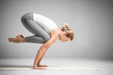 Woman standing in yoga position