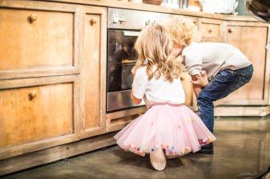 Children looking in oven