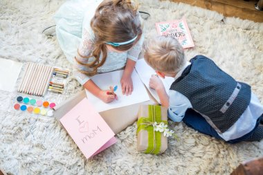 Siblings preparing present