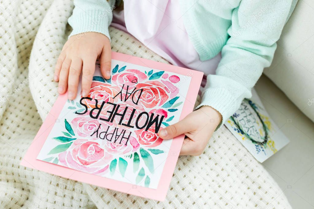 Child holding mothers day card