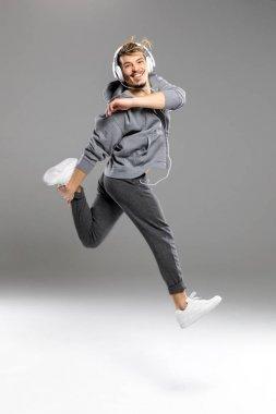 Man in headphones jumping