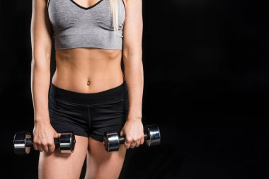 Woman exercising with dumbbells