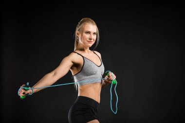 Woman with skipping rope