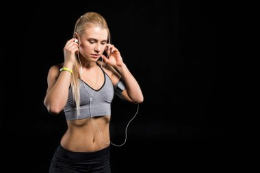 sporty woman with earphones