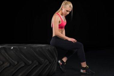 woman sitting on tire