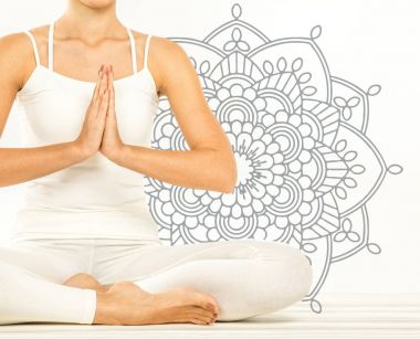 Woman sitting in lotus position