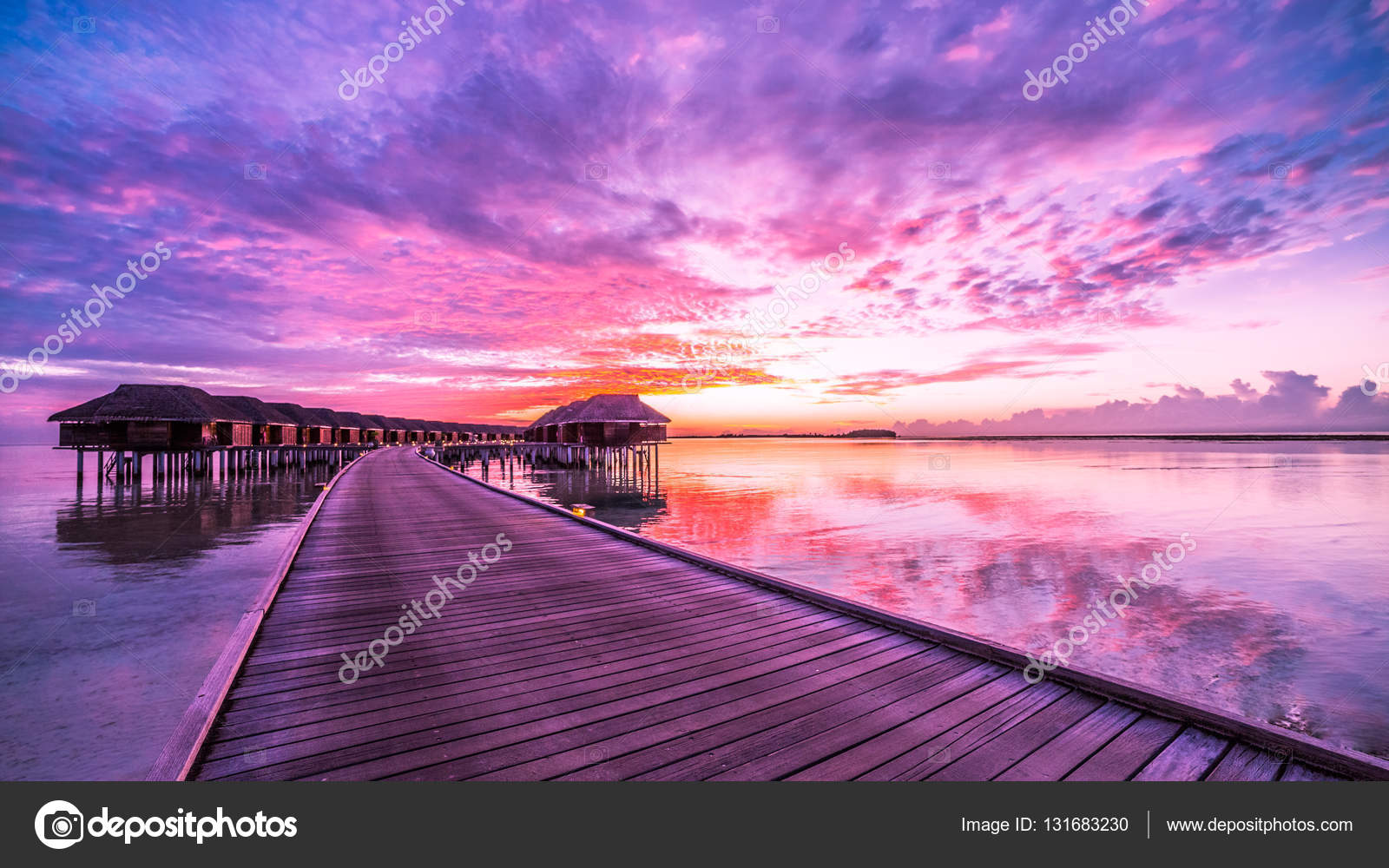 Summer travel holiday sunset on Maldives island, luxury water villas