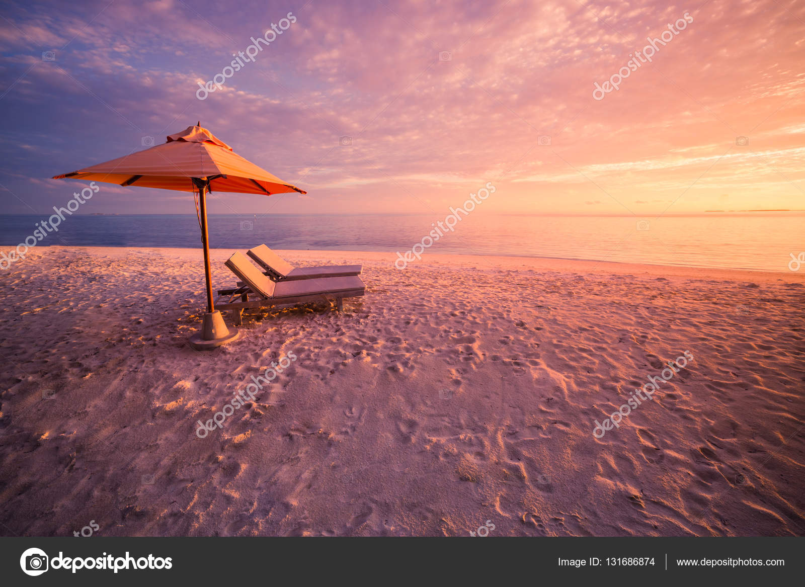 Vacation beach sunset concept two beach chairs at sunset Idyllic