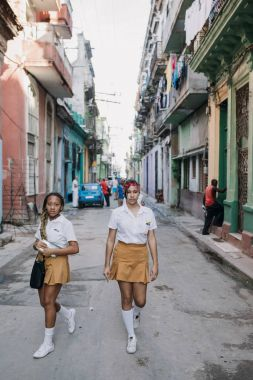 Havana, Cuba - January 5, 2017: teen schoolgirls walking down street