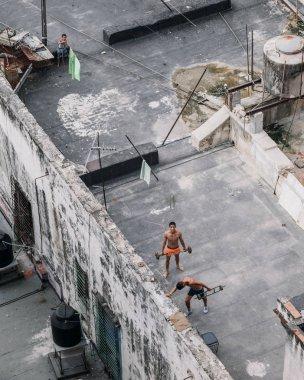 Havana, Cuba - January 6, 2017: teenagers exercising on rood of building