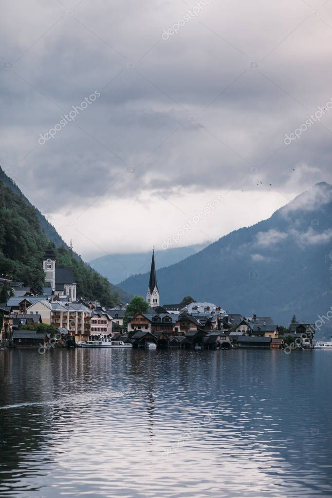 Hallstatt lakeside town reflecting in Hallstattersee lake in the Austrian Alps, Austria