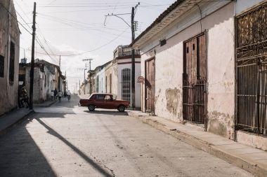 Santa Clara, Cuba - January 9, 2017: old car parked on street with shabby houses