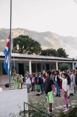 Granma, Cuba - January 20, 2017: Cuban pioneers outside school
