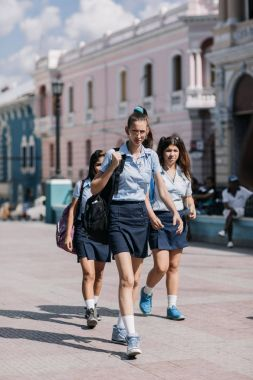Santiago de Cuba, Cuba - January 20, 2017: teen schoolgirls walking down street