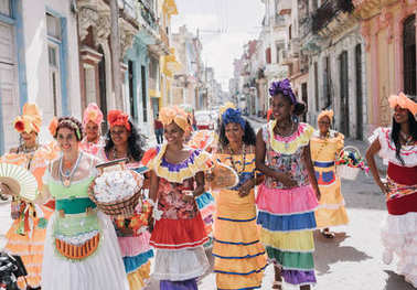 Havana, Cuba - January 22, 2017: colorful dressed women at carnival in old town
