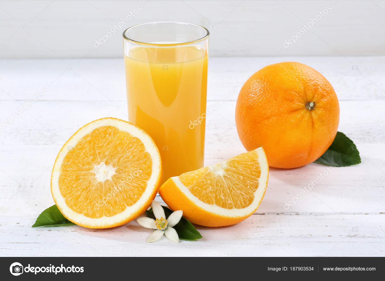 Naranjas de zumo de naranja frutas frutas de cristal Fotos de