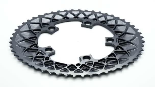 Ezüst ovális kerékpár lánctányért felszerelés forgó fehér háttér