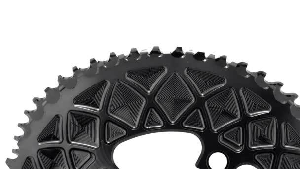 Fekete ovális kerékpár lánctányért felszerelés fehér háttér, erős közel fel együtt forgó szerkezet látható Részletek