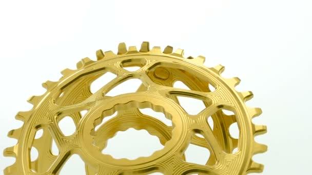 Arany ovális kerékpár lánctányért felszerelés fehér háttér, erős közel fel együtt forgó szerkezet látható Részletek