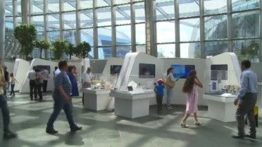 Tourist people visiting renewable energy stand pavilion in EXPO 2017
