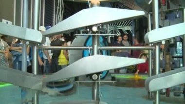 Artificial water cascades show water power to expo exhibition visitors people
