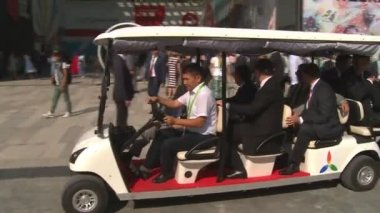 Latvia president with delegation in small electric car in EXPO 2017